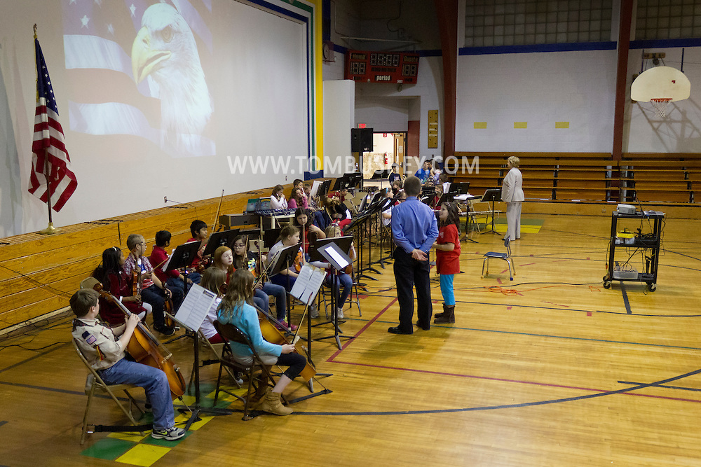 Westfall, Pennsylvania - Delaware Valley  Elementary School students practice with their instruments before playing at an assembly in the gymnasium where veterans were honored on Nov. 8, 2013.