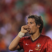 Fábio Coentrão , Portugal, after scoring  during the Portugal V Ireland International Friendly match in preparation for the 2014 FIFA World Cup in Brazil. MetLife Stadium, Rutherford, New Jersey, USA. 10th June 2014. Photo Tim Clayton