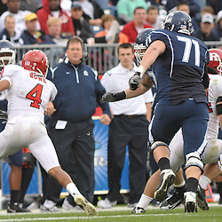 Oct 31, 2009; East Hartford, CT, USA; Rutgers cornerback David Rowe (4) returns an interception during second half Big East NCAA football action in Rutgers' 28-24 victory over Connecticut at Rentschler Field.