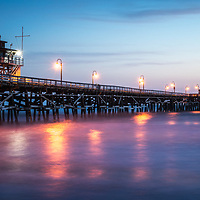 San Clemente pier at sunset panorama photo. San Clemente is a popular coastal city in Orange County in Southern California in the United States of America. Copyright ⓒ 2017 Paul Velgos with all rights reserved.