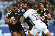 Wasps fly half Lima Sopoaga (10) is tackled by London Irish wing Curtis Rona (13) during the Gallagher Premiership Rugby match between Wasps and London Irish at the Ricoh Arena, Coventry, England on 20 October 2019.