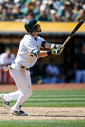 OAKLAND, CA - APRIL 17:  Josh Reddick #22 of the Oakland Athletics hits a sacrifice fly ball to drive in a run against the Kansas City Royals during the eighth inning at the Oakland Coliseum on April 17, 2016 in Oakland, California.  The Oakland Athletics defeated the Kansas City Royals 3-2. (Photo by Jason O. Watson/Getty Images) *** Local Caption *** Josh Reddick