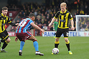Burton Albion midfielder on loan from Birmingham City Mark Duffy (21) up against Jordan Clarke of Scunthorpe United  during the Sky Bet League 1 match between Scunthorpe United and Burton Albion at Glanford Park, Scunthorpe, England on 9 April 2016. Photo by Ian Lyall.