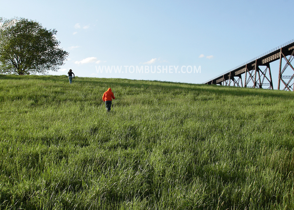 Salisbury Mills, NY- A 10-year-old girl and her 12-year-old sister hike through a field on May 10, 2009.