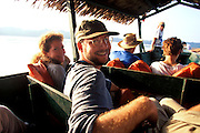 ECUADOR, AMAZON, TRAVEL Napo River, tourists in dugout canoe