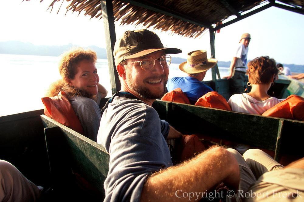 ECUADOR, AMAZON, TRAVEL Napo River, tourists in dugout canoe