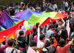 © Licensed to London News Pictures. 25/11/2012. New Delhi, India. Crowds dance and walk rainbow flag through the streets. . Homosexuals, bisexuals and transgenders take part in the Gay Pride Parade in New Delhi on 25 November 2012. Legalising homosexuality has had little impact on the deeply entrenched homophobia in India, where thousands of gays still face discrimination and a lack of basic rights. Photo credit : Andrew Ash/LNP