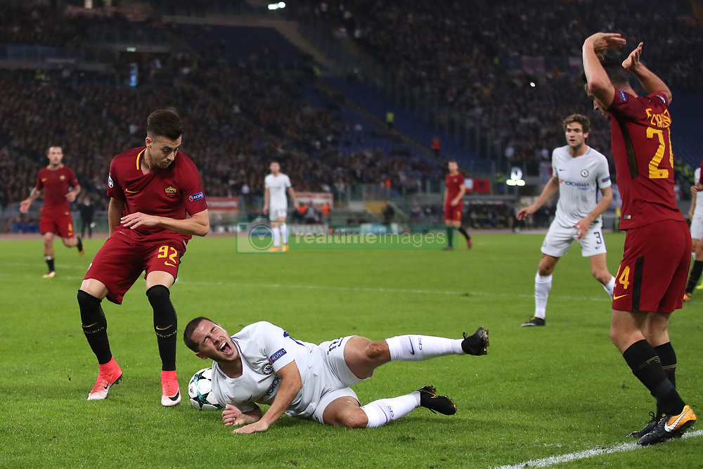 Chelsea's Eden Hazard (centre) is fouled by Roma's Alessandro Florenzi battle for the ball
