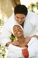 Couple in bathrobes, relaxing at health spa