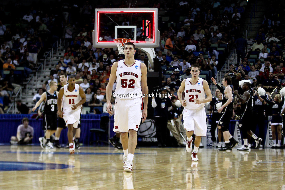 Mar 24, 2011; New Orleans, LA; Wisconsin Badgers forward Keaton Nankivil (52), guard Josh Gasser (21) and guard Jordan Taylor (11) walk off the court at halftime of the semifinals of the southeast regional of the 2011 NCAA men's basketball tournament against the Butler Bulldogs at New Orleans Arena.  Mandatory Credit: Derick E. Hingle