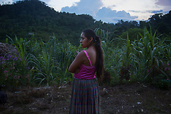 "Portrait of Carmen, 14, who is 3 months pregnant, ""I was in school until 5th grade, when I got married.  I have been raising my chickens to kill them when the baby is born."""