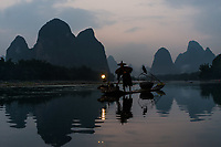 Yangshuo , China - September 29 , 2014 : fisherman fishing  with cormorant Li river, between Guilin and Yangshuo in Guangxi province  China