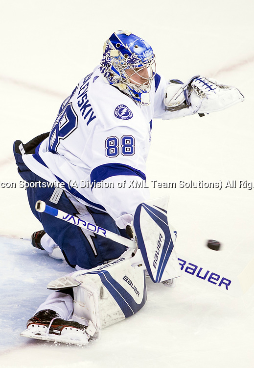 WASHINGTON, DC - MAY 21: Tampa Bay Lightning goaltender Andrei Vasilevskiy (88) makes a save in pre game warm ups before game 6 of the NHL Eastern Conference  Finals between the Washington Capitals and the Tampa Bay Lightning, on May 21, 2018, at Capital One Arena, in Washington D.C. The Caps defeated the Lightning 3-0<br /> (Photo by Tony Quinn/Icon Sportswire)