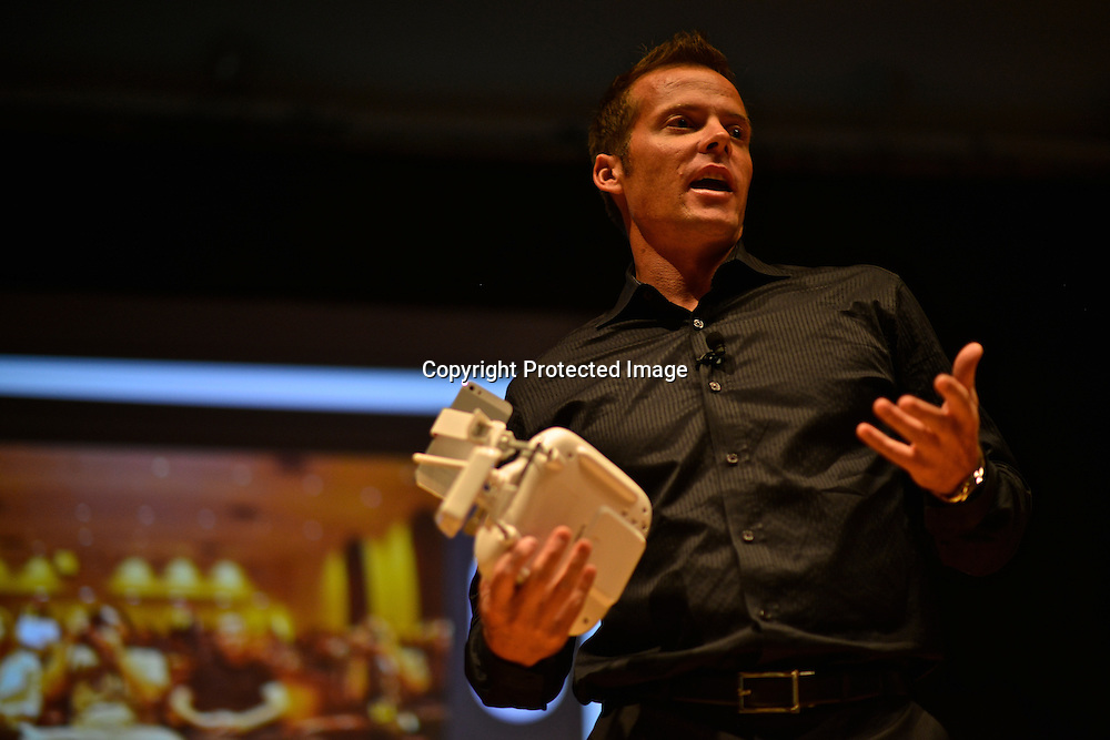 Colin Guinn talking about drones during presentation at the Drones and Aerial Robotics Conference (DARC), held at New York University. He is the creator of the Phantom drone.  Guinn is CEO of DJI Innovations, with more than 15 years in aerial photography and component design.