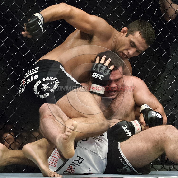 "NEWCASTLE, ENGLAND, UNITED KINGDOM, JANUARY 19 2008: Fabricio Werdum (top) throws a punch to the head of Gabriel Gonzaga during ""UFC 80: Rapid Fire"" inside the Metro Radio Arena in Newcastle, England on January 19, 2008."