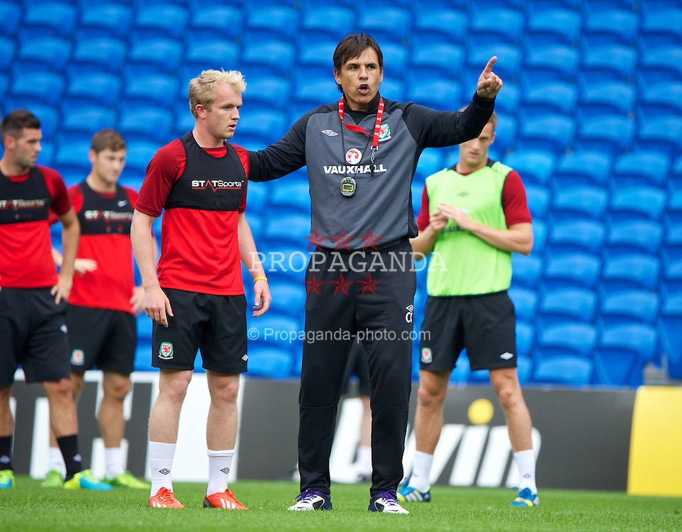 CARDIFF, WALES - Tuesday, August 13, 2013: Wales' manager Chris Coleman with Jonathan Williams during a training session at the Cardiff City Stadium ahead of the International Friendly match against the Republic of Ireland. (Pic by David Rawcliffe/Propaganda)