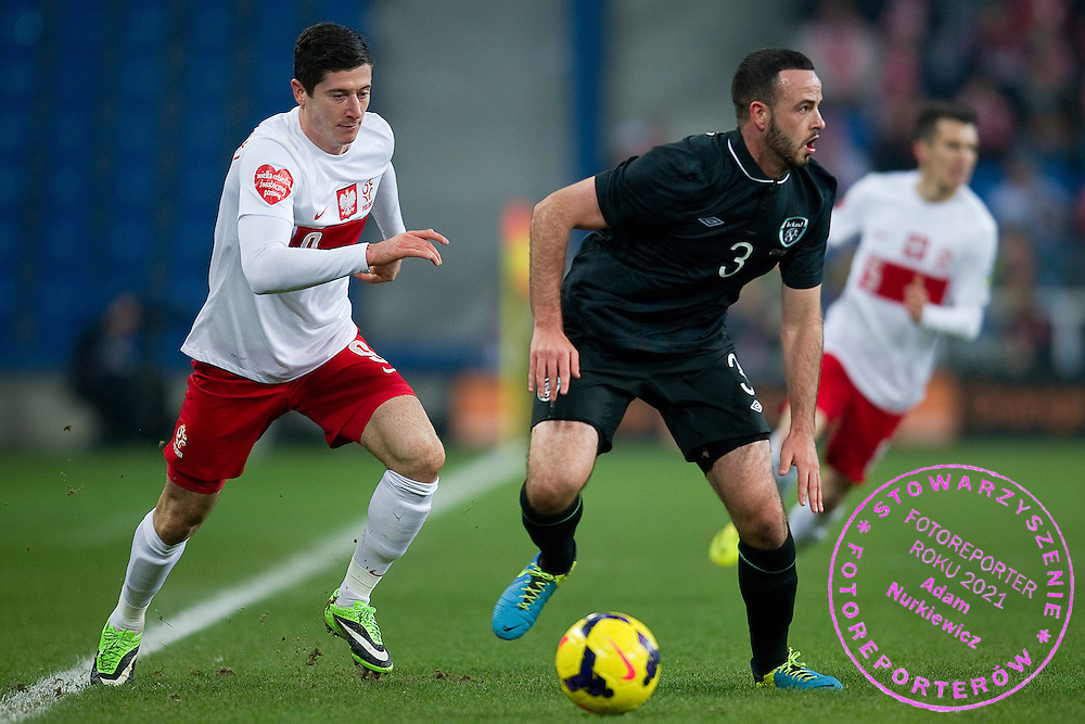 Poland's Robert Lewandowski (L) fights for the ball with Marc Wilson of Ireland (R) during international friendly soccer match between Poland and Ireland at Inea Stadium in Poznan on November 19, 2013.<br /> <br /> Poland, Poznan, November 19, 2013<br /> <br /> Picture also available in RAW (NEF) or TIFF format on special request.<br /> <br /> For editorial use only. Any commercial or promotional use requires permission.<br /> <br /> Mandatory credit:<br /> Photo by © Adam Nurkiewicz / Mediasport