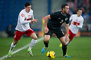 Poland's Robert Lewandowski (L) fights for the ball with Marc Wilson of Ireland (R) during international friendly soccer match between Poland and Ireland at Inea Stadium in Poznan on November 19, 2013.<br /> <br /> Poland, Poznan, November 19, 2013<br /> <br /> Picture also available in RAW (NEF) or TIFF format on special request.<br /> <br /> For editorial use only. Any commercial or promotional use requires permission.<br /> <br /> Mandatory credit:<br /> Photo by &copy; Adam Nurkiewicz / Mediasport