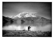 Kyrgyz woman gathering water from Karakuli Lake, Pamir Mountains, Chinese Turkestan.
