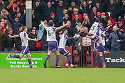 Rotherham United celebrate as Rotherham United Defender Semi Ajayi (5) scores a goal 0-2 during the EFL Sky Bet League 1 match between Scunthorpe United and Rotherham United at Glanford Park, Scunthorpe, England on 10 February 2018. Picture by Craig Zadoroznyj.