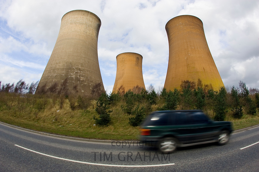 Four wheel drive vehicle passes Rugeley Power Station, Staffordshire, United Kingdom