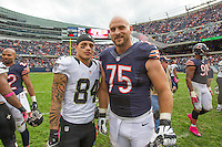 06 October 2013: Wide receiver (84) Kenny Stills of the New Orleans Saints and guard (75) Kyle Long of the Chicago Bears pose for a picture after the Saints 26-18 victory over the Bears in an NFL Game at Soldier Field in Chicago, IL.