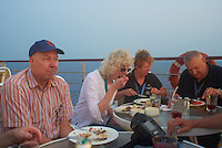Jon, Joan, Liz, and Joe Eating Dinner on Deck 6 of the M/V Explorer. Image taken with a Leica X1 (ISO 1000, 24 mm, f/2.8, 1/30 sec). Raw image processed with Capture One Pro 6, Topaz DeNoise 5 - Strong RAW, and converted to JPG/sRGB with Photoshop CS5.