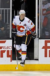 Jan 17, 2012; San Jose, CA, USA; Calgary Flames defenseman Jay Bouwmeester (4) enters the ice before the game against the San Jose Sharks at HP Pavilion. San Jose defeated Calgary 2-1 in shootouts. Mandatory Credit: Jason O. Watson-US PRESSWIRE