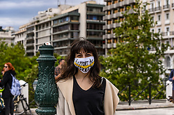 "A woman wears a protective facemask reading the message ""support artists"" as she takes part in a demonstration, in Syntagma Square, in front of the Greek parliament in central Athens, on May 7, 2020 during a rally organised by artists, musicians and actors to ask for help to the Greek government for the financial loses due to the lockdown aimed at curbing the spread of the COVID-19<br /> <br /> Pictured: <br /> Dimitris Lampropoulos  