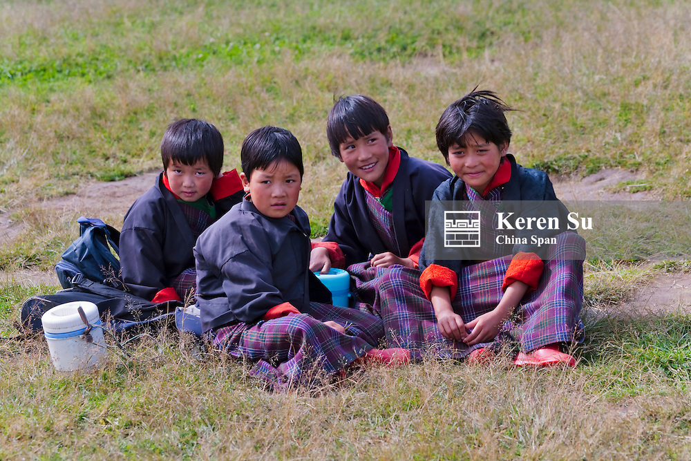 School children on meadow, Phobjikha Valley, Bhutan