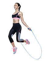 one mixed raced woman exercising fitness jumping rope exercises isolated on white background
