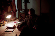 """Valentino Zeichen, is an Italian poet and writer. The last """"poet of Rome"""" photographed in his abusive home (shack) of Borghetto Flaminio.Febraury, 2004 in Rome, Italy."""
