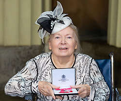 Milliner to the late Queen Mother Mr Rose Cory displays her MBE for services to the Millinery Industry following her investiture by Prince William at Buckingham Palace in London. London, December 07 2018.