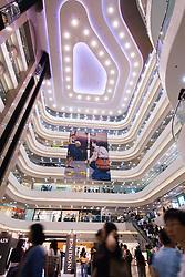 Interior of modern Times Square shopping mall in Hong Kong China