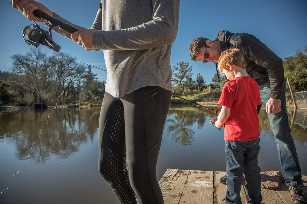 Portland resident Tyler Chester instructs his son, Caden, on the fine art of fishing at the home of his sister on an unusually warm January afternoon in the hills above Calistoga, CA.