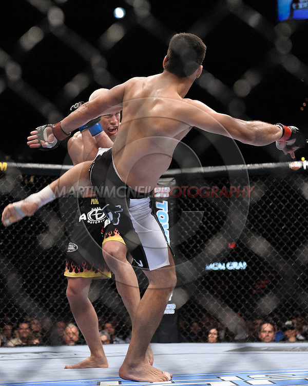 "LAS VEGAS, NEVADA, MAY 24, 2008: Tito Ortiz (facing) covers up to block a kick from Lyoto Machida during ""UFC 84: Ill Will"" inside the MGM Grand Garden Arena in Las Vegas"