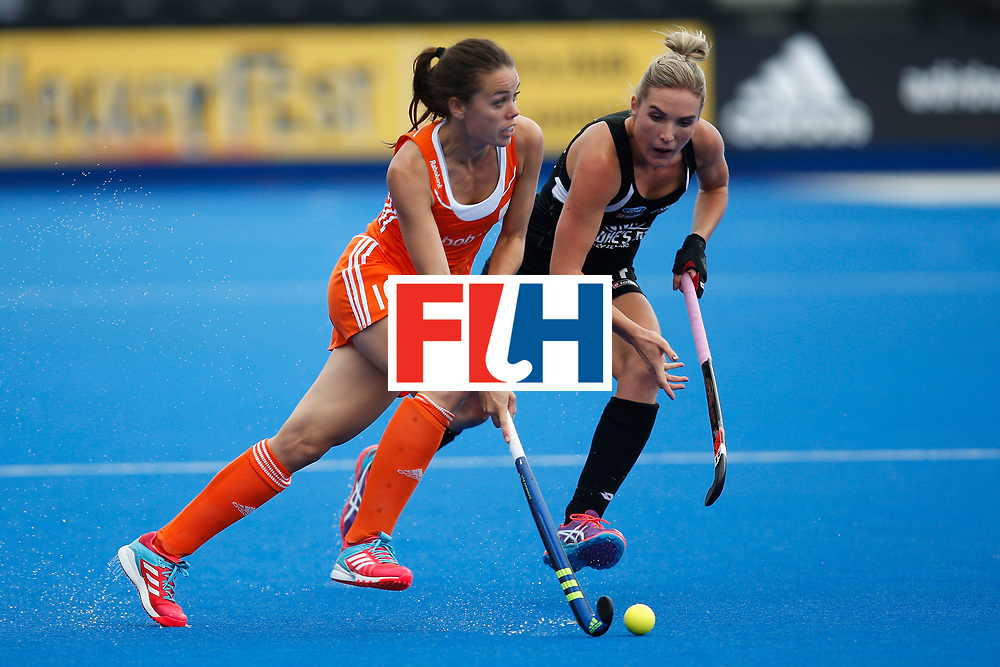 LONDON, ENGLAND - JUNE 18: Michelle van der Pols of the Netherlands takes on Sophie Cocks of New Zealand during the FIH Women's Hockey Champions Trophy 2016 match between Netherlands and New Zealand at Queen Elizabeth Olympic Park on June 18, 2016 in London, England.  (Photo by Joel Ford/Getty Images)