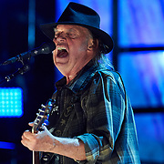 HANOVER TOWNSHIP, PA - SEPTEMBER 16:   Neil Young performs during a concert at Farm Aid 2017 on September 16, 2017 at Keybank Pavilion in Hanover Township, PA. (Photo by Shelley Lipton/Icon Sportswire)