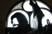 David Fode, left, and Kevin Slager of Conrad Schmitt Studios, reinstall stained glass windows at the entrance of the national shrine of Mary Help of Christians in Hubertus. (Catholic Herald photo by Sam Lucero)