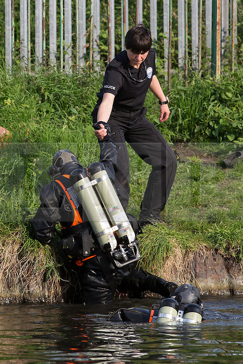 © Licensed to London News Pictures . Bridgewater Canal , Stretford , Manchester , UK . FILE PICTURE DATED 18/05/2014  of an underwater search team working at the scene . Police cordon off and search an area of towpath alongside the Bridgewater Canal , off Thomas Street in Stretford on 18th May 2014 after fears were raised that the body of a woman may be in the canal . Photo credit : Joel Goodman/LNP