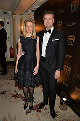 LAURENT FENIOU MD of Cartier UK and his wife CARINE FENIOU at the 26th Cartier Racing Awards held at The Dorchester, Park Lane, London on 8th November 2016.