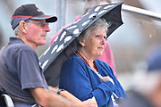 An umbrella is up as light drizzle falls during the opening day of the Specsavers County Champ Div 1 match between Somerset County Cricket Club and Surrey County Cricket Club at the Cooper Associates County Ground, Taunton, United Kingdom on 18 September 2018.