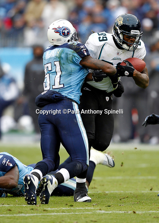 Tennessee Titans linebacker Gerald McRath (51) tackles Jacksonville Jaguars tight end Marcedes Lewis (89) after a pass reception during the NFL week 13 football game on Sunday, December 5, 2010 in Nashville, Tennessee. The Jaguars won the game 17-6. (©Paul Anthony Spinelli)