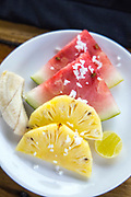 VARKALA, INDIA - 27th September 2019 - Fruit salad breakfast with watermelon, pineapple, banana, grated coconut and lime, Varkala Cliff Beach, Kerala, Southern India