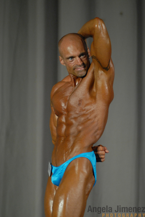 Scott Nelson, of Minneapolis, Minnesota, poses during the Physique (bodybuilding) competition 40-49 year old age group lightweight division at McGaw Memorial Hall/Welsh-Ryan Arena at Northwestern University in Evanston, Illinois during the Gay Games VII competition on July 19, 2006. <br />  <br /> <br /> Nelson finished third in the modified category in his division. <br /> <br /> Over 12,000 gay and lesbian athletes from 60 countries are in Chicago competing in 30 sports during the Games from July 15 through 22, 2006. <br /> <br /> Over 50,000 athletes have competed in the quadrennial Games since they were founded by Dr. Tom Wadell, a 1968 Olympic decathlete, and a group of friends in San Francisco in 1982, with the goal of using athletics to promote community building and social change. <br /> <br /> The Gay Games resemble the Olympics in structure, but the spirit is one of inclusion, rather than exclusivity. There are no qualifying events or minimum or maximum requirements.<br /> <br /> The Games have been held in Vancouver (1990), New York (1994), Amsterdam (1998), and Sydney (2002).