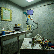 March 27, 2012 - Dublin, Ireland: General view of the kitchen area at the Billion Euro House art installation by the Irish artist Frank Buckley. ..Worthless euros, taken out of circulation and shredded by Irelands Central Bank, formes the interior walls of an apartment that Mr. Buckley does not own in a building left vacant by the countrys economic ruin...The artist decided to call the apartment  built from thousands of bricks of shredded, decommissioned cash (each brick contains, roughly, what used to be 50,000 euros)  the Billion Euro House. He reckons that about 1.4 billion euros actually went into it, but the joke, of course, is that it is worth simultaneously so much and so little...A large gravestone beside the main door, announces that Irish sovereignty died in 2010, the year that the government accepted an international bailout so larded with onerous conditions that the Irish will be paying for it for years to come. (Paulo Nunes dos Santos/Polaris)