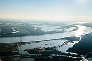 Nederland, Zuid-Holland, Hardinxveld-Giessendam, 07-02-2018; Nieuwe-Merwede, ontpolderde polder Noordwaard en Brabantse Biesbosch, gezien vanuit de Sliedrechtse Biesbosch (voorgrond).<br /> River New Merwede and national park Biesbos (freshwater tidal wetlands)<br /> <br /> luchtfoto (toeslag op standard tarieven);<br /> aerial photo (additional fee required);<br /> copyright foto/photo Siebe Swart