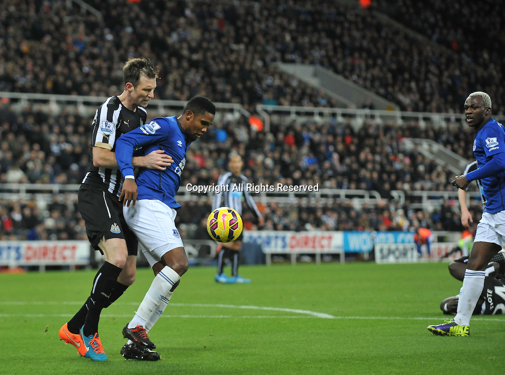 28.12.2014. Newcastle, England. Premier League. Newcastle versus Everton. Samuel Eto'o of Everton shields Mike Williamson of Newcastle United from the ball