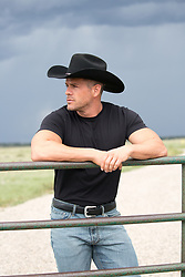 handsome rugged cowboy on a ranch