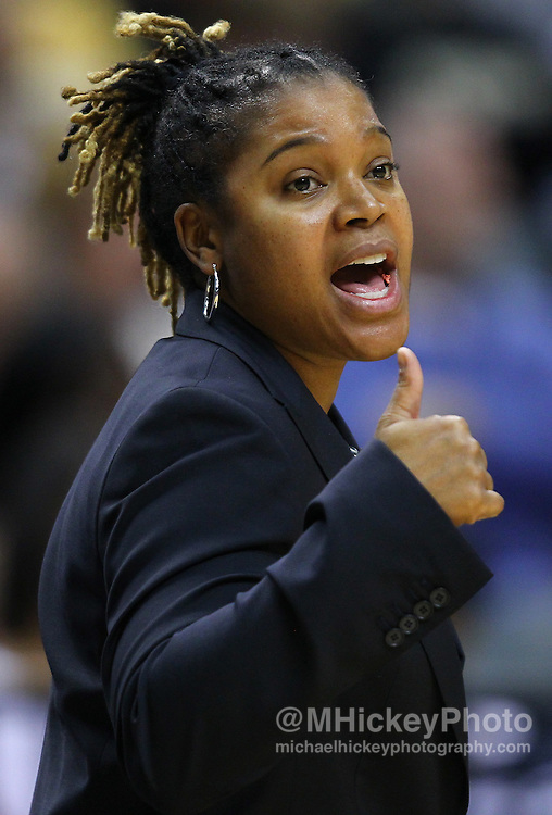 March 03, 2012; Indianapolis, IN, USA; Penn State Lady Lions head coach Coquese Washington talks to her players from the sidelines against the Purdue Boilermakers during the semifinals of the 2012 Big Ten Tournament at Bankers Life Fieldhouse. Purdue defeated Penn State 68-66. Mandatory credit: Michael Hickey-US PRESSWIRE
